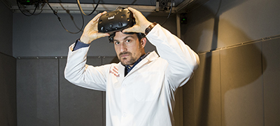 Stanford neurobiologist Andrew Huberman stands for a portrait in a virtual reality lab at the Huberman Lab in the Department of Neurobiology at Stanford School of Medicine in Palo Alto, Calif., on Monday, May 14, 2018. Huberman is working on a clinical trial using virtual reality to restore vision.